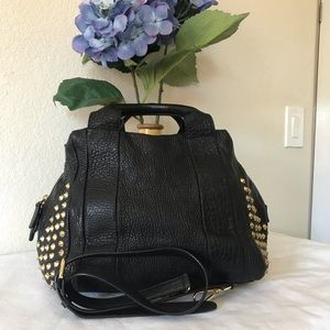 MCM black with studs on both side